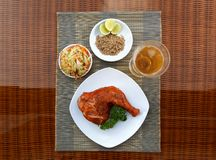 Grilled chicken on white plate with parsley, salad and beer outdoors Royalty Free Stock Photos