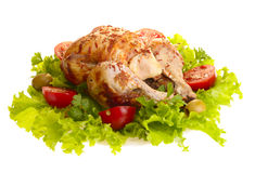 Grilled chicken whole with vegetables Stock Image