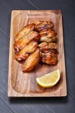 Grilled chicken wing Stock Images