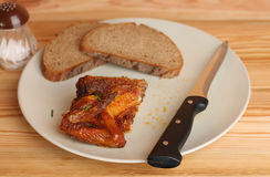 Grilled chicken wing with bread on white plate Royalty Free Stock Photos