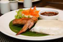 Grilled chicken wing and sticky rice Royalty Free Stock Photography