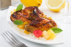 Grilled chicken wings. Served over rice and tropical fruit Royalty Free Stock Photos