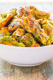Grilled Chicken Wings. In a bowl vertical image Stock Image