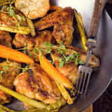 Grilled chicken wings with caramelized carrots Royalty Free Stock Image