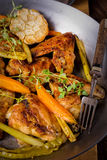 Grilled chicken wings with caramelized carrots Royalty Free Stock Photo