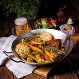 Grilled chicken wings with caramelized carrots Stock Photos