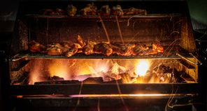 GRILLED CHICKEN WINGS WITH CHARCOAL stock photography