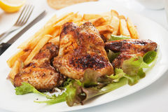 Grilled chicken wings with french fries Stock Image