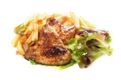 Grilled chicken wings with french fries Stock Photo