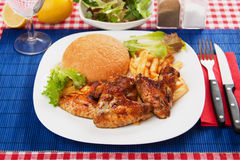 Grilled chicken wings with french fries Royalty Free Stock Photo