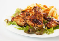 Grilled chicken wings with french fries Royalty Free Stock Photos