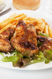 Grilled chicken wings with french fries Stock Photography