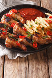 Grilled chicken wings with french fries and ketchup close-up. ve Stock Image