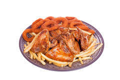 Grilled chicken wings with French fries and onions rings Stock Images