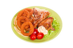 Grilled chicken wings with French fries and onions rings Royalty Free Stock Photo