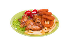 Grilled chicken wings with French fries and onions rings Stock Photography