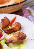 Grilled chicken wings with ketchup and greens. Stock Image