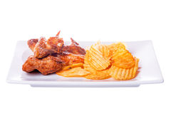Grilled chicken wings with potato chips isolated on white Royalty Free Stock Image