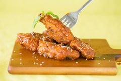 Grilled Chicken Wings with Red Spicy Sauce Stock Images