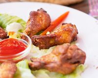 Grilled Chicken Wings with Red Spicy Sauce Royalty Free Stock Photos