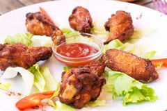 Grilled Chicken Wings with Red Spicy Sauce Stock Photography