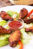 Grilled Chicken Wings with Red Spicy Sauce Royalty Free Stock Photography