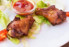 Grilled Chicken Wings with Red Spicy Sauce Stock Image
