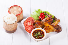 Grilled Chicken Wings with Red Spicy Sauce and Sticky Rice Royalty Free Stock Image