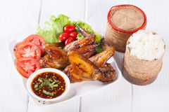 Grilled Chicken Wings with Red Spicy Sauceand Sticky Rice Stock Photography