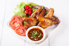 Grilled Chicken Wings with Red Spicy Sauceand Sticky Rice Royalty Free Stock Images