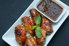 Grilled Chicken Wings with Red Spicy Thai style Stock Image