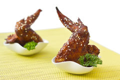 Grilled chicken wings with sesame seeds. Isolated Royalty Free Stock Images