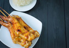 Grilled chicken wings and sticky rice in dish Stock Image