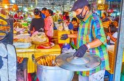 Grilled chicken wings in Talad Saphan Phut market, Bangkok, Thailand