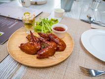 Grilled chicken wings with tomato sauce on the table in restaurant.Thai food style. royalty free stock image