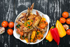 Grilled chicken wings, with vegetables. Stock Image