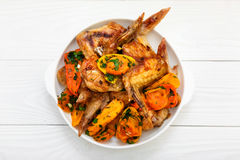 Grilled chicken wings, with vegetables. Royalty Free Stock Photo