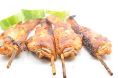 Grilled chicken wings on white dish Royalty Free Stock Photography