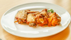Grilled chicken wings on a white plate Royalty Free Stock Image