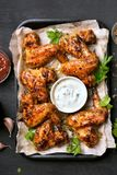 Grilled chicken wings with white sauce Stock Images