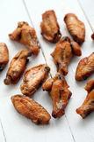 Grilled chicken wings on a white table Royalty Free Stock Photos