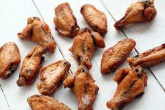 Grilled chicken wings on a white table Stock Photos