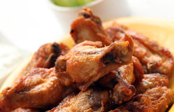 Grilled chicken wings on a white table Royalty Free Stock Photography
