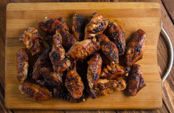 Grilled chicken wings on the wood Stock Photos