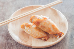 Grilled chicken wings on wooden plate Stock Photo