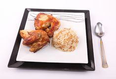 Grilled chickens with rice meal. On double dishes royalty free stock photo