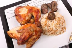 Grilled chickens with rice meal. On double dishes royalty free stock images