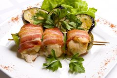 Grilled chiken meat wraped in bacon stock images