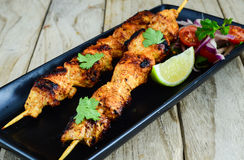Grilled cnicken kebab served with salad and lime Royalty Free Stock Photo