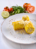 Grilled corn on the cob with butter. On a white plate Stock Photo